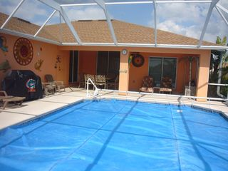 Cape Coral house photo - solar cover for winter also electric pool heater. table for 8 & 8 more seats