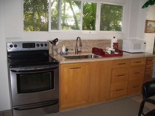 Makaha studio photo - Oak cabinets, granite kitchen countertop, range, all paper products included