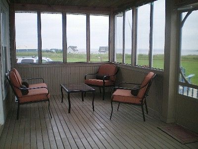 Screened in porch overlooking the ocean all around...with very comfy seating!