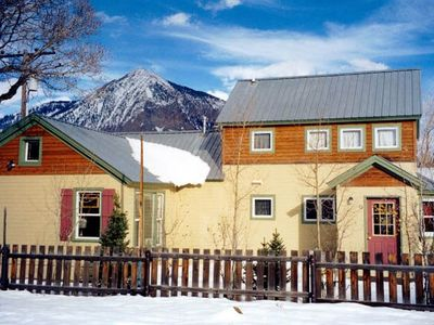 side view of cottage with Mt. Crested Butte in background