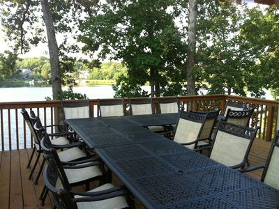 Enjoy a beautiful meal on the deck by the lake.