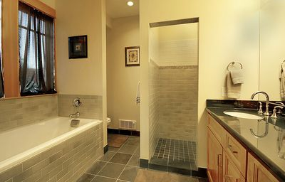 Master bath features dual sink vanity, walk in shower & large soaking tub