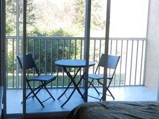 Sun Lake condo photo - Read a book or enjoy the sunset relaxing in our screen patio.