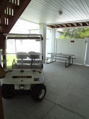 Garden City Beach house photo - Golf cart available if rented and this is the area underneath house.