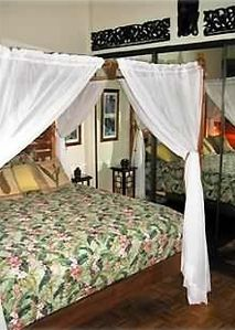 Another view of master bedroom, Balinese furnishings and art