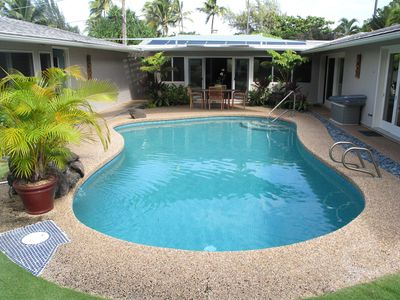 Home surrounds the pool