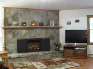 Seven Springs house photo - Field stone fireplace with electric insert