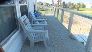 Galveston house photo - Street side deck has afternoon shade.Rabbits play in the garden across the road