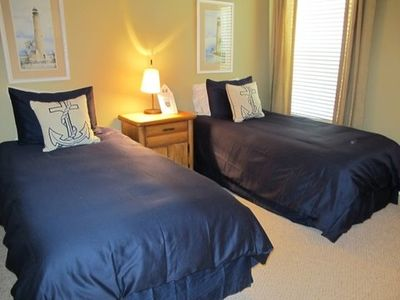 Second bedroom with twin beds in Nautical style includes TV and DVD.