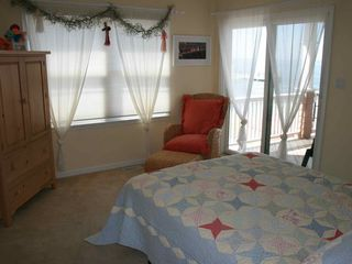 Bedroom, with queen-sized bed, entrance to back porch - Holgate house vacation rental photo