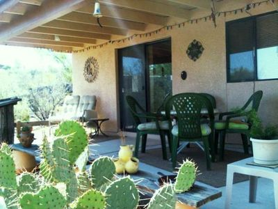 Back porch seating, patio doors access living room
