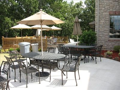 Enjoy the outdoor patio at the clubhouse, pool side.