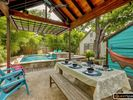 Enjoy your meals with your friends and family under this covered cabana