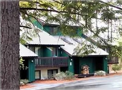 Nestled among towering pine trees, 1 mile north of N. Conway village