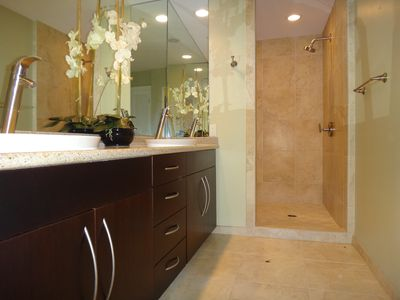 Enjoy luxurious granite counters, double sinks and huge shower in master bath