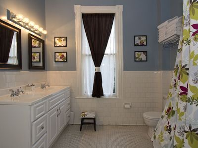 Our large bathroom has a double vanity and a tub/shower.
