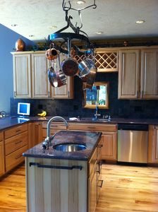 Gourmet kitchen with granite countertops, Viking range, 2 sinks, TV.