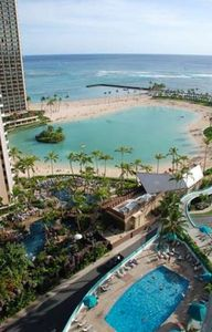 View of Ilikai pool, Hilton river pool,  lagoon and surf from your lanai
