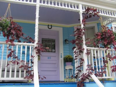Welcome to Daisy! Front porch door the year the hanging pots went wild...
