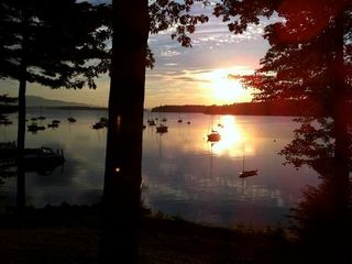 Center Harbor cottage photo - Sailboats at sunset