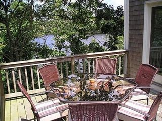 Chatham house photo - Enjoy an outdoor meal on the deck overlooking the blue pond