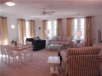 Spacious great room w/comfortable, over-stuffed furniture & dining area for