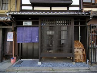 Typical Machiya Design - degoushi lattices and inuyarai curved bamboo barriers - Kyoto townhome vacation rental photo