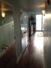 Sanibel Island condo photo - Master bedroom hallway. Two large closets and two dressers for storage galore!