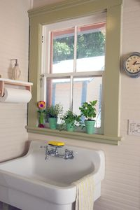 The sunny kitchen has a farmhouse sink