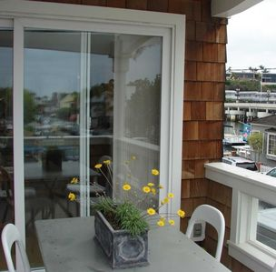 2nd floor balcony with outdoor dining table