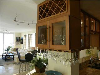 Navarre Beach condo photo - .Stemware above refrigerated wine cabinet