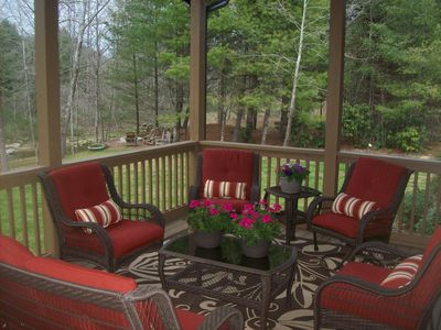 Relax in the comfortable seating on the back porch