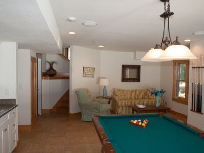 Game room with pool table, tv, wet bar, sitting area