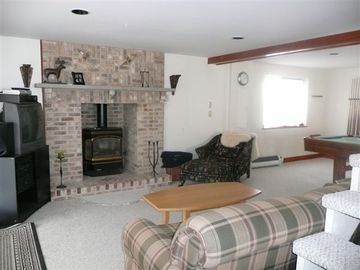 Basement with gas fireplace, pool table, ping pong, darts and bar