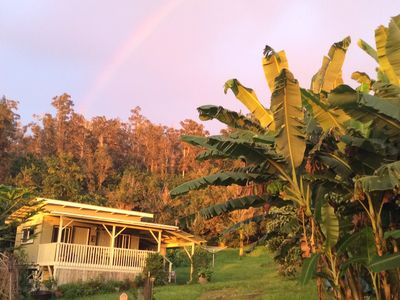 Rainbow over the eco-cottage at sunset.