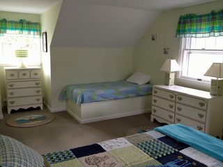 Chatham house photo - Bedroom with three twin beds has plenty of room to play and 'lil kids toys/books