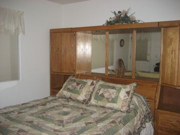 The second bedroom has a queen size comfortable bed and darkening blinds.
