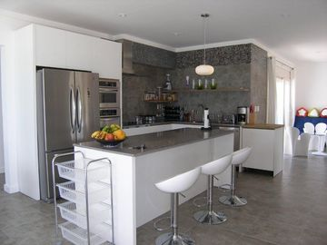 .Fully equipped chef's kitchen with all modern appliances and ocean view