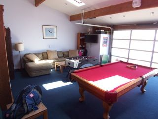 GAME ROOM POOL TABLE FOOSBALL TV ETC