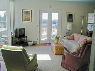 Deer Isle house photo - The large living room has sunroom to left and doors to the deck.