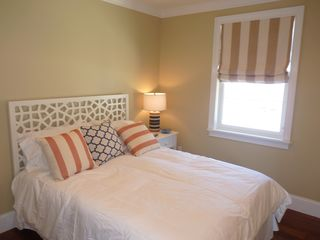 Newport condo photo - A comfy feather bed Bedroom with private bathroom