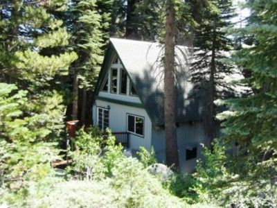 Tucked in the pines, this lovely home is situated on a flat lot and has a private deck.