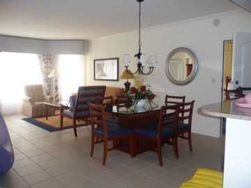 Dining room and living room at the Surf Club- doors to balcony - flat screen