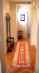 The hallway separates the rooms from one another for privacy and full use by all