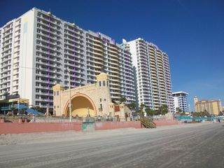 View of the magnificient Ocean Walk Resort from the beach! - Daytona Beach condo vacation rental photo