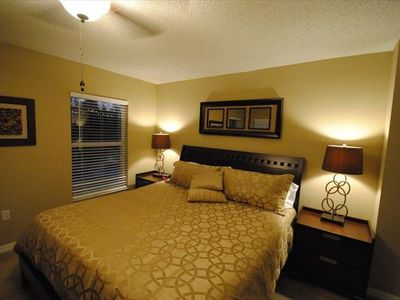 Master King bedroom with 32' flat screen TV on wall, walk in closet & en-suite