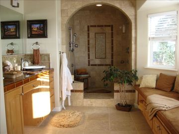 Travertine & glass tile walk-in shower, dual vanity & bay window in Master suite