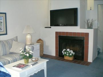 Boardwalk condo rental - living room with 42 inch plasma tv, dvd player, electric fireplace