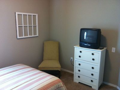 Guest bedroom with cable TV.