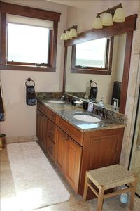 Master Suite Bath with walk in steam shower, double sinks, heated floors!